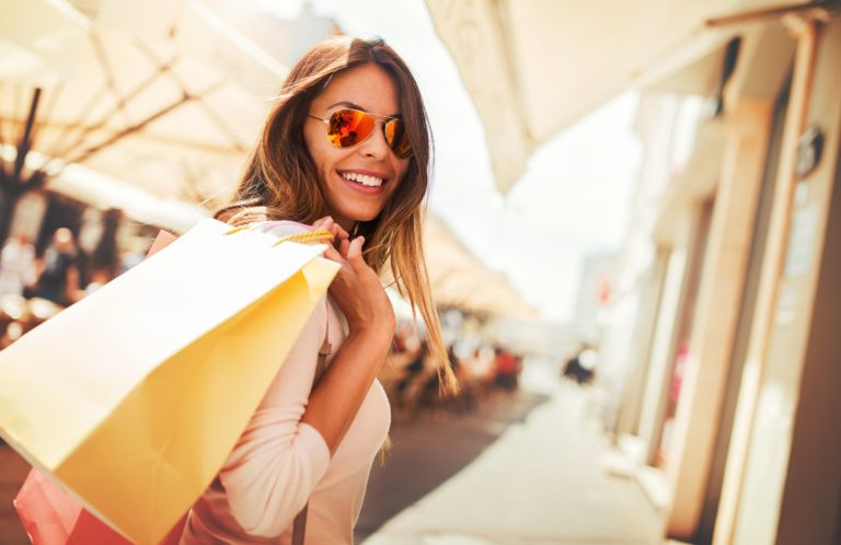 Image of a women holding shopping bag