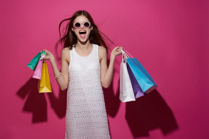 Excited Women With Shopping Bags