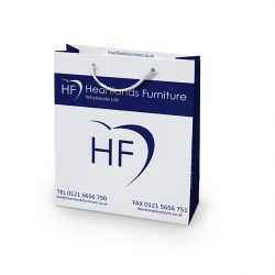 Heartlands furniture white and blue paper bag