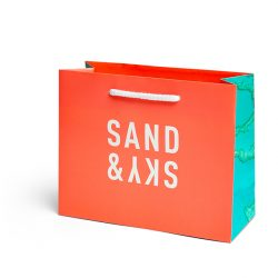 Sand and sky orange paper bag