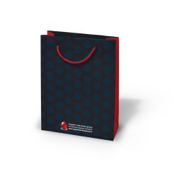 Support services group black and blue dotted paper bag